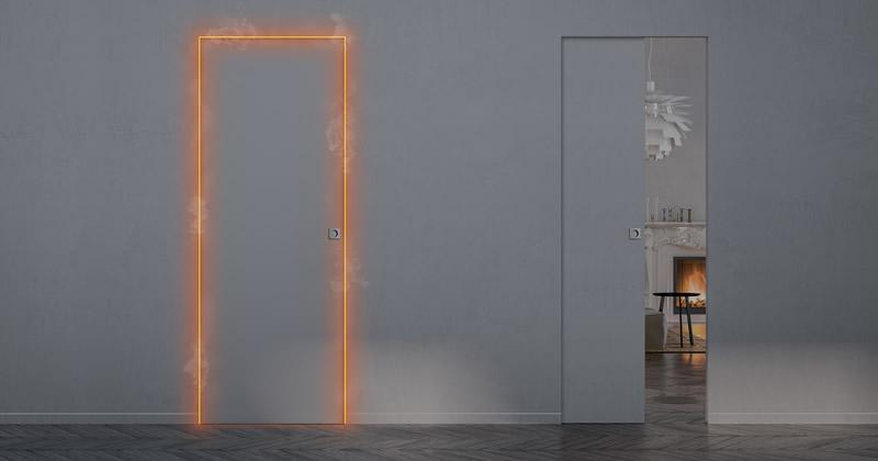 ECLISSE Syntesis EI30: il design minimal delle porte battenti filo muro e delle porte a scomparsa senza cornici esterne diventa resistente al fuoco